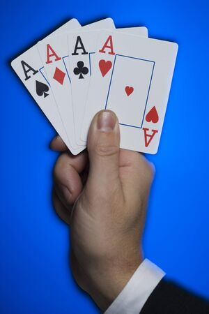 Close-Up Of A PersonS Hand Holding Four Aces