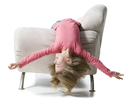 Girl Lying Upside Down On A Couch LANG_EVOIMAGES