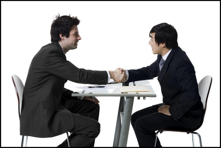 introductions: Profile Of Two Businessmen Shaking Hands