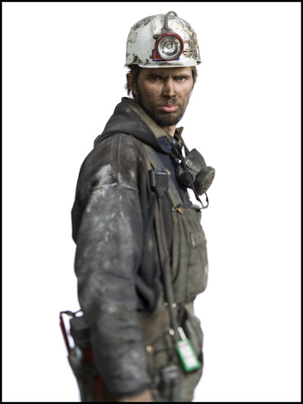 clutter: Profile Of A Miner Wearing A Hardhat With A Headlamp