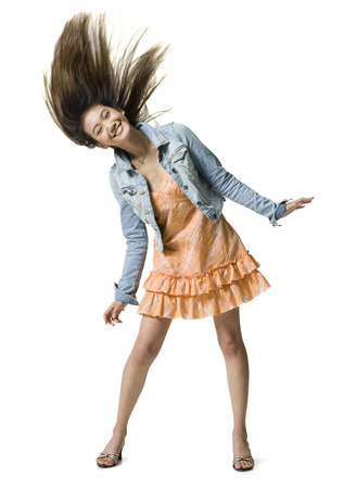 Young Woman Tossing Her Hair LANG_EVOIMAGES