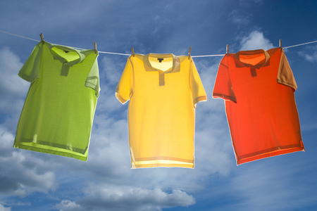 Low Angle View Of Polo Shirts Pined On A Clothesline LANG_EVOIMAGES