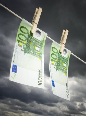 Low Angle View Of Two One Hundred Euro Banknotes Pegged On A Clothesline