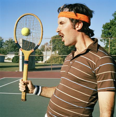 Profile Of A Young Man Holding A Tennis Racket