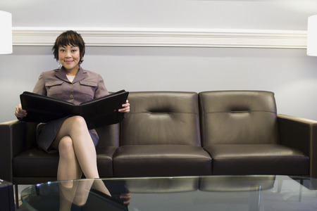 lamp shade: Portrait Of A Businesswoman Sitting On A Couch With A Portfolio LANG_EVOIMAGES