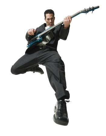 Low Angle View Of A Businessman Playing The Guitar