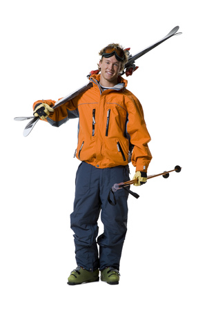 skiers: Portrait Of A Young Man Holding Skis And Ski Poles