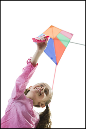Close-Up Of A Girl Flying A Kite