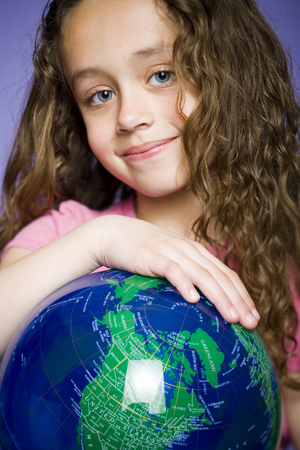 Portrait Of A Girl Holding A Globe