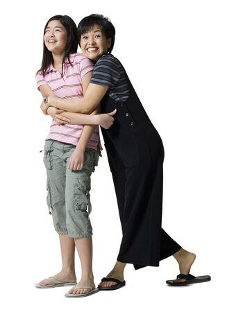 embraced: Portrait Of A Mother Hugging Her Daughter LANG_EVOIMAGES