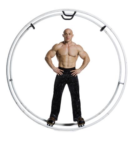 Male Bodybuilder Posing In German Wheel