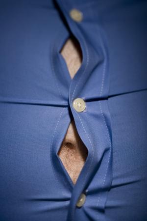 Close-Up Of Fat Stomach Bursting Through Shirt LANG_EVOIMAGES