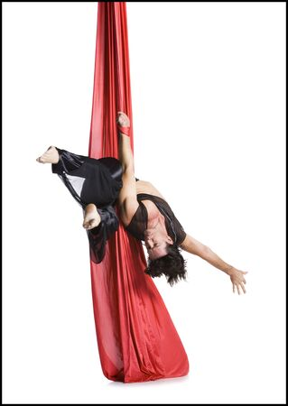 Male Circus Gymnast Tangled In Red Drapes