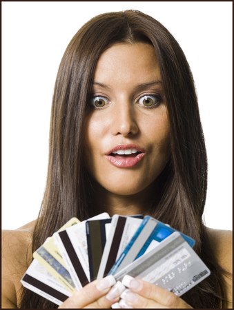 Woman Holding Several Credit Cards LANG_EVOIMAGES
