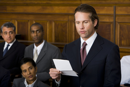 Juror Standing In A Jury Box And Reading The Verdict