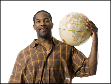 African American Man Resting Globe On Shoulder LANG_EVOIMAGES