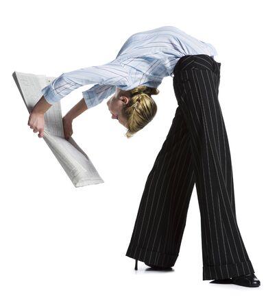 Female Contortionist Businesswoman Bending Over Backwards LANG_EVOIMAGES