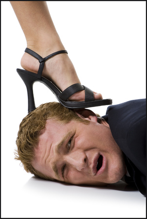 Woman Stepping On ManS Head