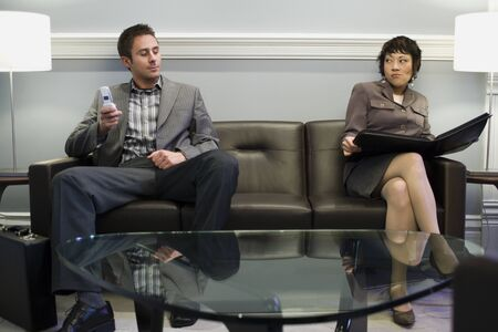 lamp shade: Businessman Sitting With A Businesswoman On A Couch