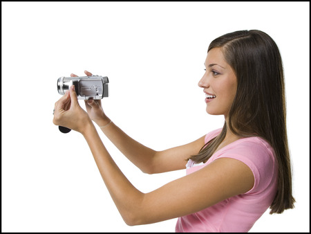 documenting: Profile Of A Young Woman Holding A Video Camera