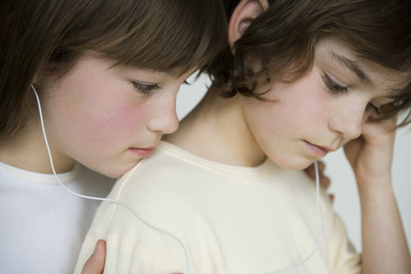 Close-Up Of Two Girls Listening To Music