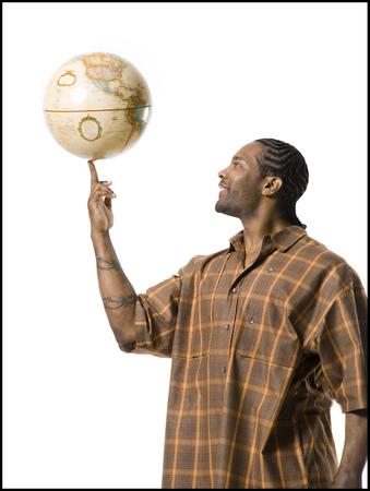 African American Man Spinning Globe On Finger