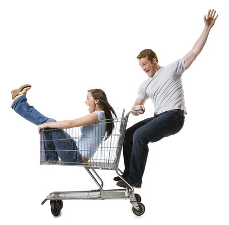 hurried: Man Pushing Shopping Cart With Girlfriend Inside