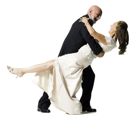 Profile Of A Senior Couple Dancing
