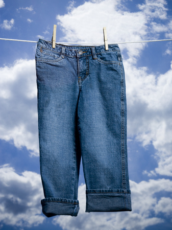 Close-Up Of A Pair Of Jeans Hanging On A Clothesline LANG_EVOIMAGES
