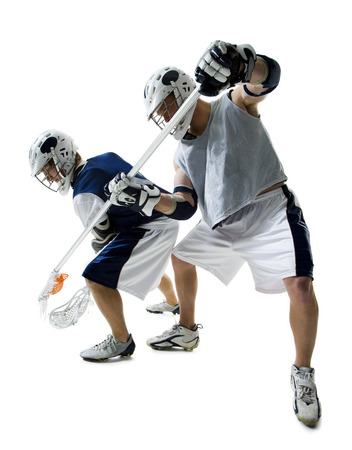 Two Young Men Playing Lacrosse LANG_EVOIMAGES