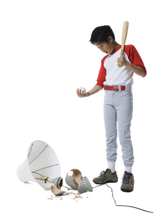 Boy Holding A Baseball Bat With A Ball, Looking Down At A Broken Lamp
