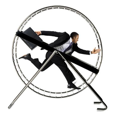 Businessman Running In Hamster Wheel LANG_EVOIMAGES