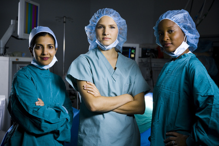 Three Women In Scrubs With Arms Crossed