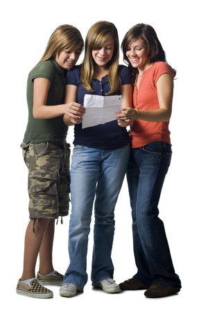 Three Girls Reading A Letter Smiling LANG_EVOIMAGES