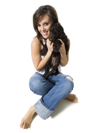 Woman Sitting Cross Legged With Puppy