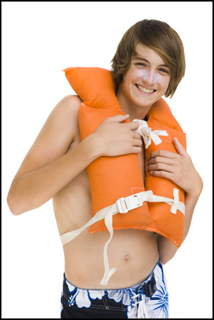 lifevest: Boy In Swim Trunks With Life Vest