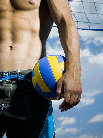 Volleyball Player Standing By Net