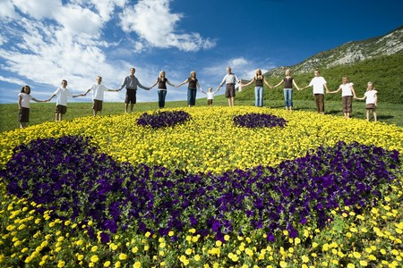 Large Family Group On Hill With Happy Face Floral Display