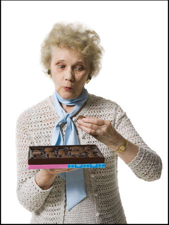 aging woman: Older Woman Holding A Box Of Chocolates