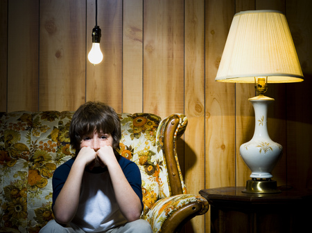 Boy On Sofa With Light Bulb And Lamp LANG_EVOIMAGES