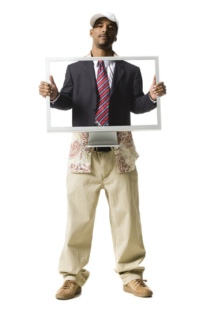Man With Computer Monitor And Business Attire LANG_EVOIMAGES