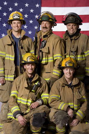 Group Portrait Of Firefighters With Us Flag LANG_EVOIMAGES