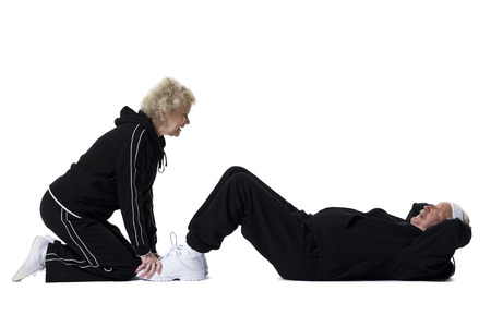 aging woman: Older Man Doing Sit-Up Exercises