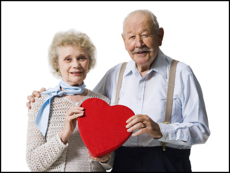 aging woman: Older Man Giving Wife Valentines Chocolate