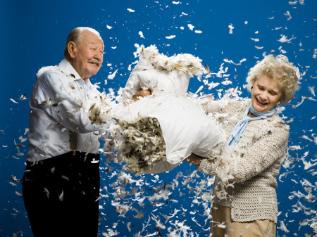 Older Couple Pillow Fighting