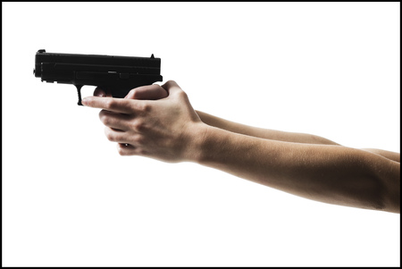 WomanS Arms Holding A Handgun