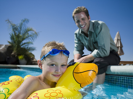 Father And Son At Swimming Pool