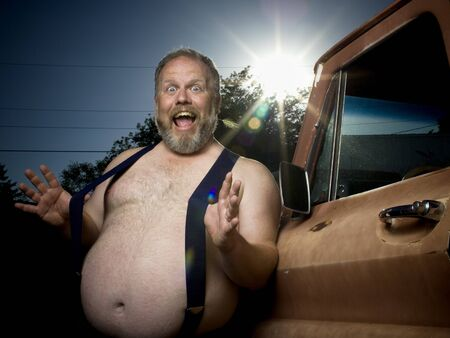 Overweight Man With Suspenders By Truck