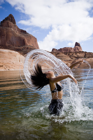 Woman In Water With Rock Formations