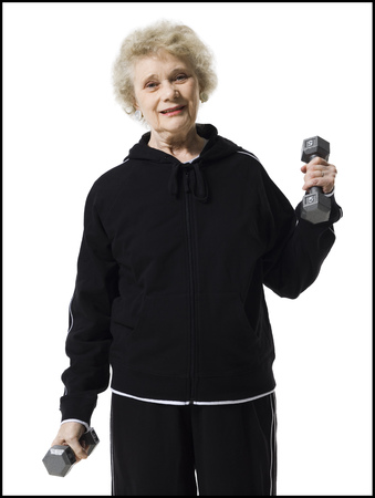 aging woman: Older Woman Doing Dumbbell Exercises
